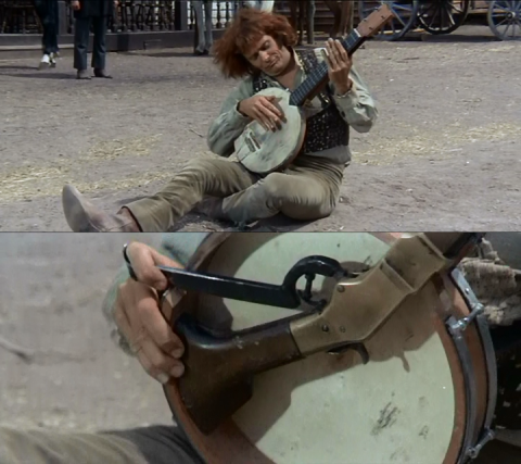 """Banjo"" playing his banjo rifle, from the film ""Sabata"" (1969)."