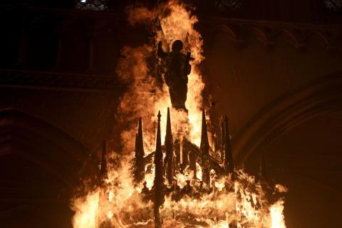 The only church that illuminates is a burning church.