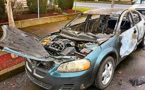 A picture of a a burnt-out car that was recently torched in Portland.