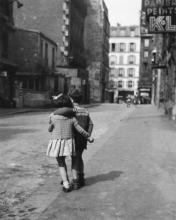 little girl and boy hugging each other
